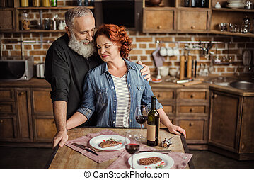 Mature couple in kitchen - Happy mature couple in love...