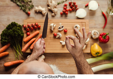 Man preparing vegan food - Overhead view of senior man...