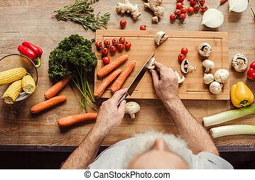 Man preparing vegan food - Overhead view of senior man...