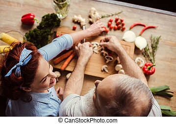 Couple preparing vegan food - Overhead view of mature couple...