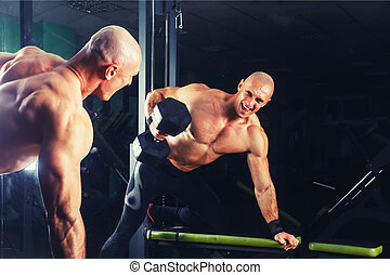 power athletic guy , execute exercise press with dumbbells,...