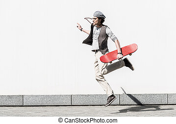 Active teenager is spending time on street dynamically - In...