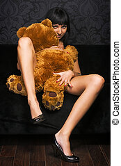 Love with Teddy bear - Beautiful naked girl is holding a...