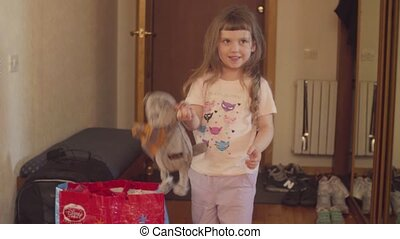 A girl playing stuffed toy