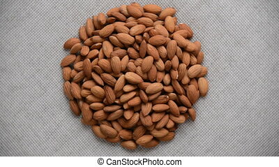 The nut almond rotates on the turntable. - Nuts almond turn...