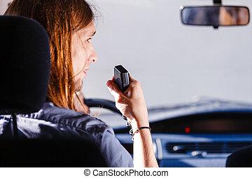 Young man driving car using cb radio - Talking while drive,...