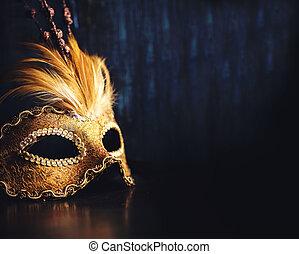Venetian mask - Golden venetian ball mask over dark...