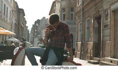 Teenager Couple with Motorbike - Young attractive man...