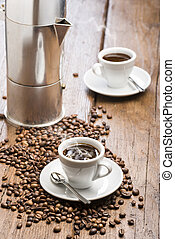 coffee - cup of coffee with coffeepot and coffee beans on...