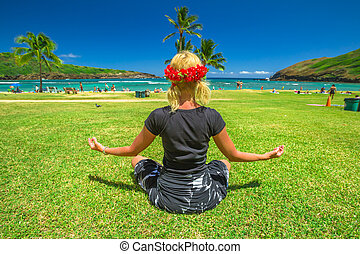 Yoga meditation in Hawaii - Serene meditation yoga. Woman...