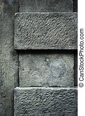 Detail of stone pillar - abstract background or texture dark...