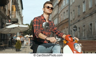 Young Handsome Hipster on Motorbike - Young attractive man...