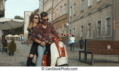 Hipster Couple Riding Motorbike - Young attractive couple of...