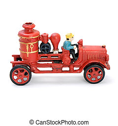 Antique red wind-up car. Isolated image.