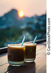 Coffee for two with romantic sunset view