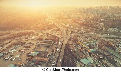 Aerial Drone Flight Footage of highway and overpass with...