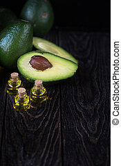 Oil of avocado on a dark wooden background