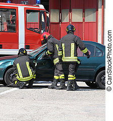 Firefighters during rescue after road accident