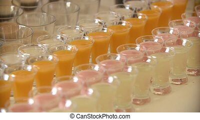 Glass shots with different kinds of juice.