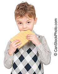Little boy eating waffle - Portrait of happy little boy...