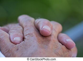 Old man's crossed hands - Close up pf old man's hands with...