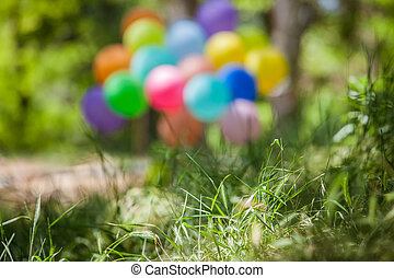 Blurred background. Holiday balloons in the clearing