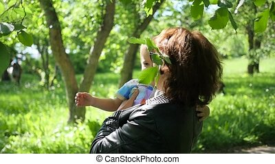 The grandmother of the child is resting, playing in the Park. The outdoors