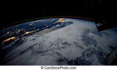 Planet Earth at night seen from the space. Elements of this video furnished by NASA.