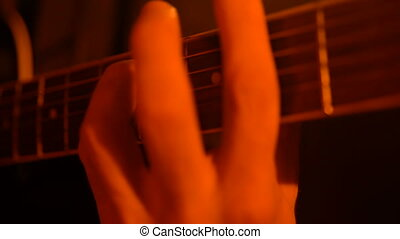 Man playing guitar close-up