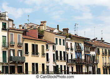 Facades of houses in the historic city center of Padua....