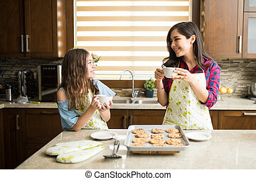 Mom drinking coffee with daughter