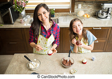 Happy mom and daughter baking