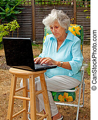 Lady On A Laptop - An elderly woman using a laptop computer...