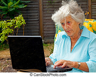 Elderly Lady Using Laptop - A senior woman using a laptop...
