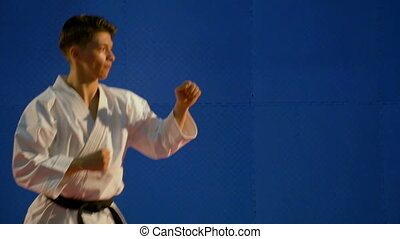 Karate young man kicking during training in slow motion