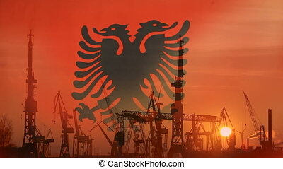 Industrial concept with Albania flag at sunset, silhouette...