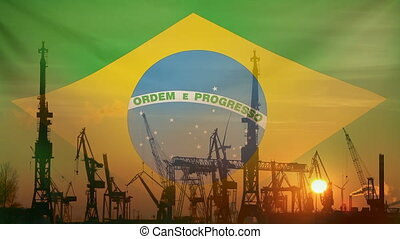 Industrial concept with Brazil flag at sunset, silhouette of...