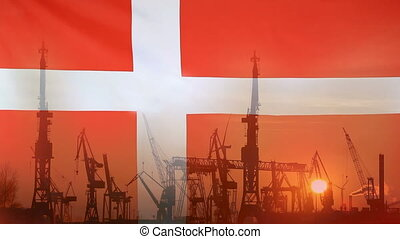 Industrial concept with Denmark flag at sunset, silhouette...