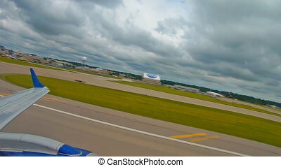passenger plane takes off at Cleveland airport - Cleveland,...
