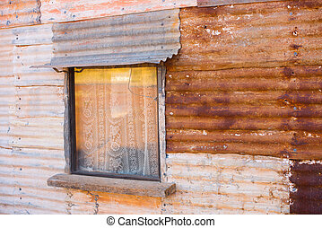 Corrugated rustic iron house wall with window - Old rustic...