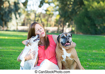 Mature woman with dog pets relaxed in park - Portrait active...
