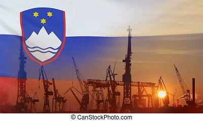 Industrial concept with Slovenia flag at sunset, silhouette...