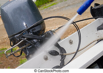 Pressure Washing a Boat - Pressure washing a small boat,...