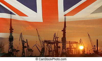 Industrial concept with United Kingdom flag at sunset,...