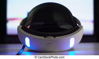 Virtual reality VR headset for video gaming console in male...