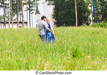 Happy young couple in a summer park. Love concept.
