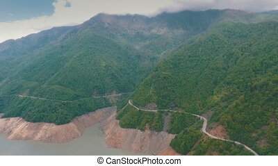 mountain road along the river,shooting at the drone,shooting...