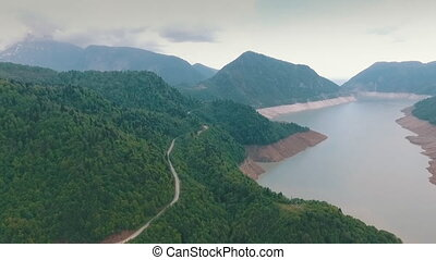 Scenic view of the winding asphalt road along the river, the...