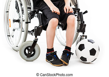 Disabled child boy sitting on wheelchair holding soccer ball