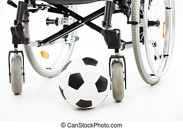 Wheelchair for invalid or disabled person and soccer ball...
